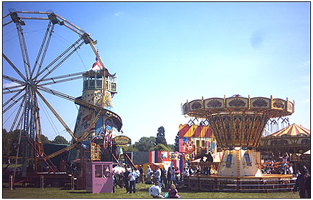 the scene at a funfair A london ambulance service spokesman said they had been called just after 8pm to the scene at yiewsley  met police said they were called to reports of a woman falling from a ride at a fun fair .